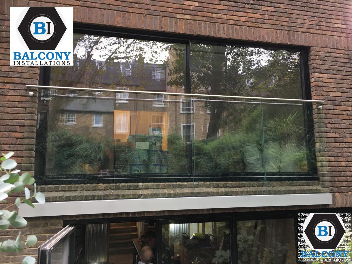 Juliet Balcony - Frameless side fixed channel Balcony Installations.jpg