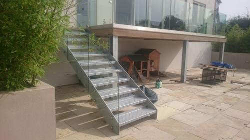 Balcony Installations - frameless laminated glass on steel stairs and decking