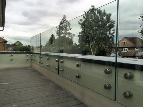 Balcony Installations side fixed glass balustrades without handrail
