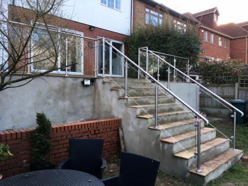 Balcony installations modular glass balustrades and stairs on garden patio - designed and fitted